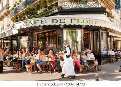 PARIS - SEPTEMBER 10, 2006: People at the busy Cafe de Flore in Saint-Germain-des-Pres, Paris, France