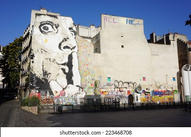 PARIS - SEPTEMBER 18: The wall filled with graffiti near Pompidou Centre on SEPTEMBER 18, 2014 in Paris, France. Centre Georges Pompidou houses the largest museum for modern art in Europe.