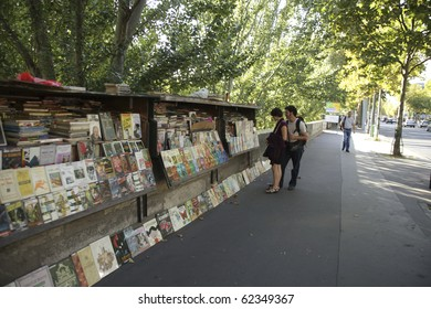 PARIS - SEPTEMBER 19: Second-hand book market on quai of river Seine near cathedral Notre Dame de Paris on September 19, 2010. The bookmarket on the banks of the Seine is there since the 16th century