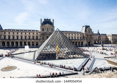 PARIS, SEPTEMBER 2018, Aerial view of the Louvre museum. The main pyramid which serves as entrance and the triangular pools can be seen, as well as the exterior of the Denon pavilion.