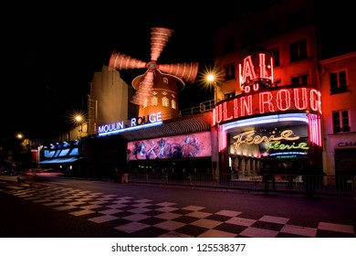 PARIS - SEPTEMBER 3: Advertising cabaret show on facade of Moulin Rouge, famous cabaret and theater on September 3, 2012 in Paris, France