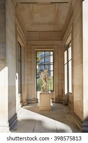 PARIS - SEPTEMBER 30: Palace Galliera interior with statue and windows in sunlight view on September 30, 2015 in Paris, France. Palais Galliera is an example of neo-reinassance architecture.