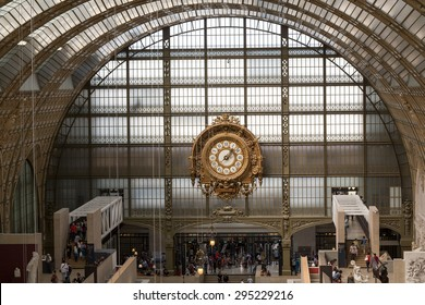 PARIS -SEPTEMBER 7, 2014: Golden clock of the museum D'Orsay in Paris, France. Musee d'Orsay has the largest collection of impressionist and post-impressionist paintings in the world.