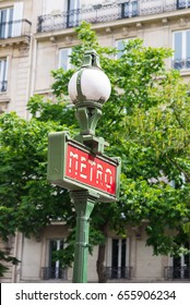Paris, sign of the subway in the street
