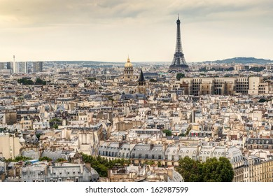 Paris skyline with Eiffel Tower at sunset, France. Paris cityscape background. Panoramic above view of Paris in the evening.