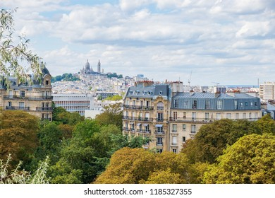 Paris skyline with Montmartre hill and Sacre Coeur Basilica viewed from Buttes-Chaumont Park.