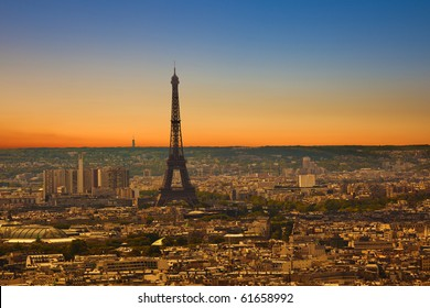 Paris skyline from the Sacre Coeur at a summer sunset. Eiffel tower area view