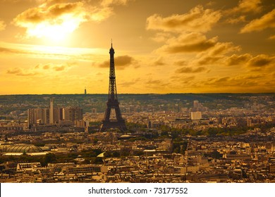 Paris skyline from the Sacre Coeur at sunset. Eiffel tower area focused