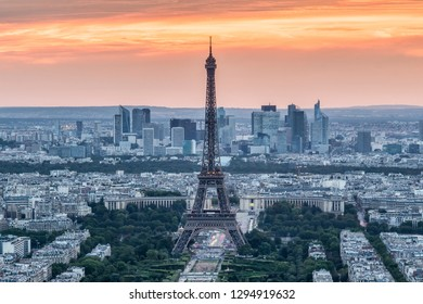 Paris skyline at sunset, France. With Eiffel Tower and business district