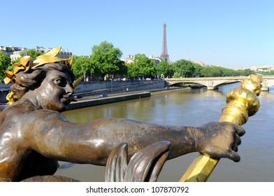 Paris, statues an details of the Alexandre III bridge