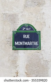 """Paris' street sign of """"Rue Montmartre"""" (Montmartre street) in the 2nd district, the very central part of Paris."""