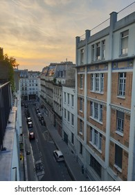 Paris street view from top balcony during sunset