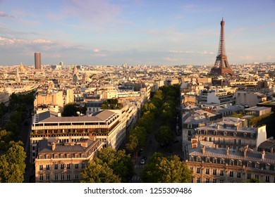 Paris sunset city view with Eiffel Tower and Champs Elysees avenue.