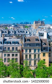 Paris, typical roofs in the Marais, aerial view with the Saint-Eustache church and the Defense in background