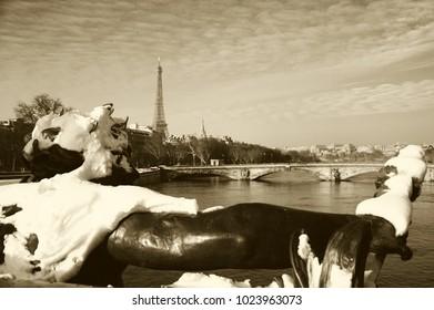 Paris under snow. View from Alexandre III Bridge. Eiffel tower at background. Sepia photo.