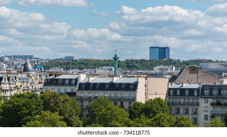 Paris, view of ile Saint-Louis, the Bastille statue and towers in background, modern and ancient buildings