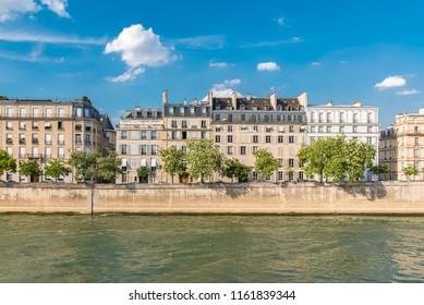 Paris, view of ile saint-louis and quai d'Orleans, typical facades and quays in summer