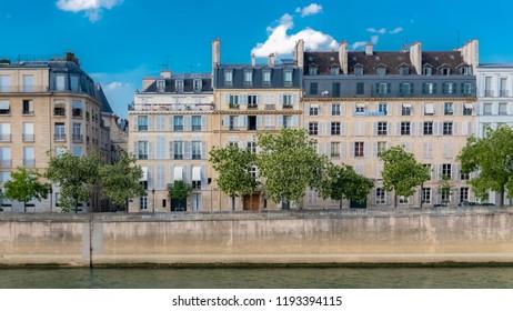 Paris, view of ile saint-louis and quai d'Orleans, typical facades and quays in summer