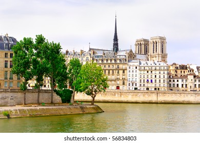 Paris - view on Seine river, Notre Dame and a quayside with buildings and trees