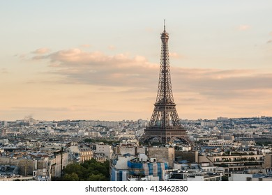 Paris view from the top of Arc de Triomphe de l'Etoile on Sunset. Eiffel Tower on the background. France.