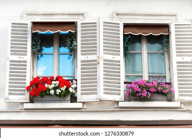 Paris windows with flowers on Montmartre street