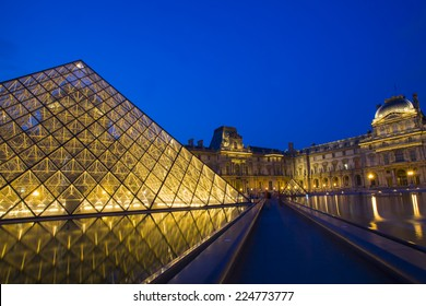 PARIS-16 JUL: Louvre Museum at night in summer on 16 July, 2013. Lourve is the most popular and  the one of the world's largest museums. The glass Pyramid as a landmark is in front of the museum.
