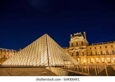 PARIS-29 JAN: Louvre Museum at twilight time on 29 Jan, 2017. Lourve is the world's largest museums. The glass pyramid as a landmark is in front of the museum.