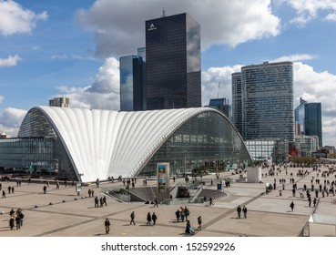PARIS,APRIL 19:People walking among buildings in the major business district, La Defense,in the western of Paris,France on April 19 2012. Here are many of the Paris urban area's tallest high-rises