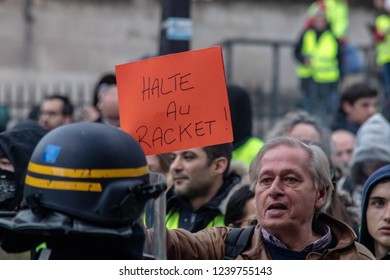 "Paris/France -11.24.2018 Protest ""'Yellow Vests"" (Gilets Jaunes) against the government of Emanuel Macron Place de La Madeleine.  People speaking with the gendarmes"