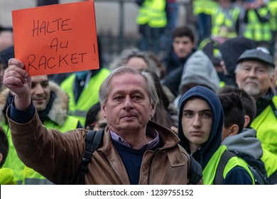 "Paris/France -11.24.2018 Protest ""'Yellow Vests"" (Gilets Jaunes) against the government of Emanuel Macron Place de La Madeleine.  People speaking with the gendarmes"