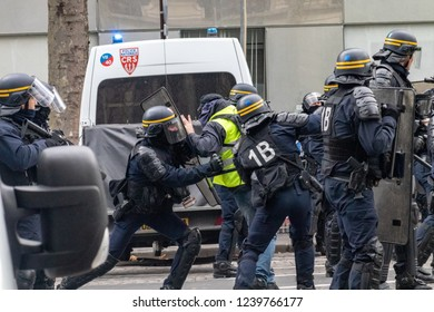 "Paris/France -11.24.2018 Protest ""'Yellow Vests"" (Gilets Jaunes) against the government of Emanuel Macron Place de La Madeleine.  Altercations between gendarmes and protesters"