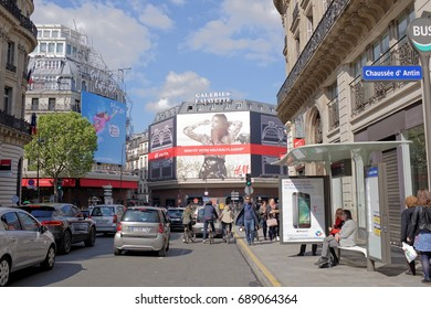 Paris,France- April 29, 2017: La Fayette shopping center, view from the Boulevard Haussmann.On the street pedestrians and moving vehicles