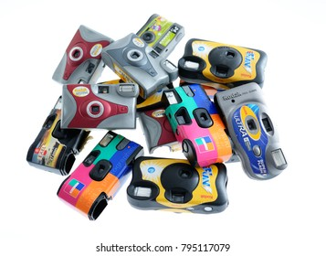 Paris,France - January 16, 2018: Set of used, cheap, disposable cameras. It is a collection of diffrent brand which makes it looking like colorful pattern on white background. For 35mm analog film.