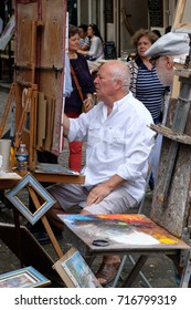 PARIS,FRANCE - JULY 31,2017 : Painter at the Place du Tertre in the historic district of Montmartre
