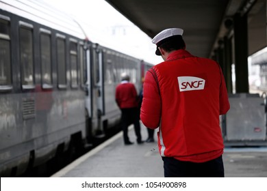 Paris,France Mar. 22,2018. Railway worker stands in platform on Gare de Bercy railway station during a nationwide strike by French SNCF railway workers