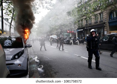 Paris,France May 1,2018.A car burns after young masked protesters attacked shops and cars during a march for the annual May Day workers' rally.