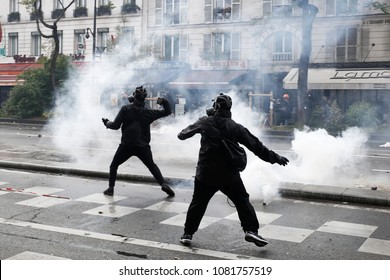 Paris,France May 1,2018.Masked youth protesters clash with French police forces during a march for the annual May Day workers' rally.
