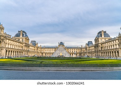 Paris/France - Sept 2018: Dramatic panoramic view of La Lourve and historical landmark buildings. Historical architecture concept.