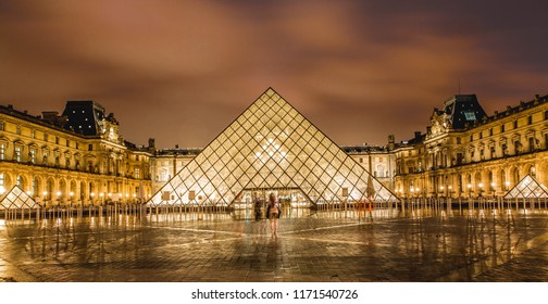 Paris,France-03.16.2018: Louvre museum at Night. Louvre is one of the most popular tourist destinations in world.
