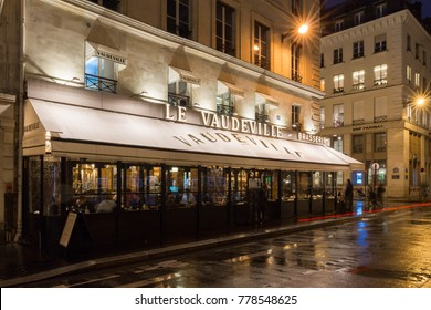 Paris,France-17 December 2017: The traditional French brasserie Le Vaudeville at night. It is located near Brogniart palace in Paris, France.