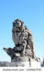 PARIS-FRANCE-FEB 24, 2019: Boy and Lion, one of the statues on Alexandre III bridge in Paris, France. Boy and Lion.