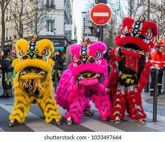 Paris,France-February 25,2018: Three colorful traditional Chinese lions posing in the street during the 2018 Chinese New Year parade in Paris.