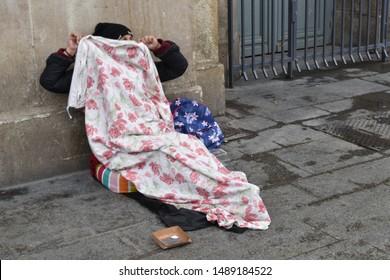 Paris,france,gare du nord. 02/19/2019. shy beggar outside gare du nord train station.