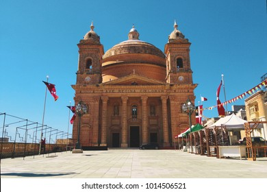 Parish Church of the Assumption of the Blessed Virgin Mary into Heaven. Old church with a yellow stone in L-Im?arr, Malta.