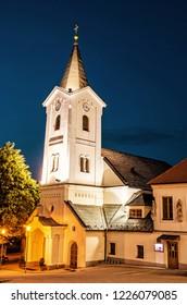 Parish church of the assumption, Nitra, Slovak republic. Religious architecture. Night scene. Cultural heritage. Yellow photo filter.