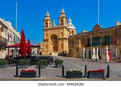 Parish Church of Our Lady of Pompei on main square of Mediterranean fishing village Marsaxlokk, Malta