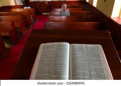 Parishoner sitting in pew listening to Gods word Bruce Peninsula, Ontario, Canada - June 18, 2005