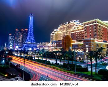 Parisian casino with car light trail