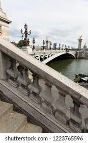 Parisian view Pont Alexandre III over Seine river in Paris