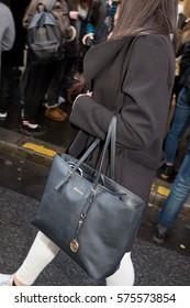 PARIS-JANUARY 24, 2015. Street fashion bag. Men's wear and Haute couture. Paris fashion week.